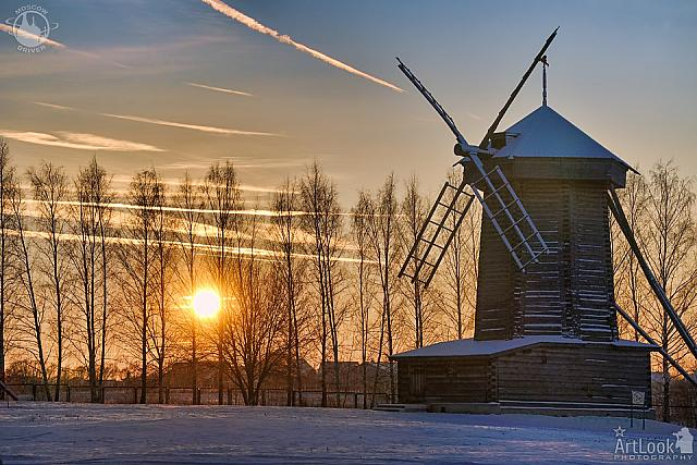 Amazing Winter Sunset Behind Trees at the Tent-Roof Windmill