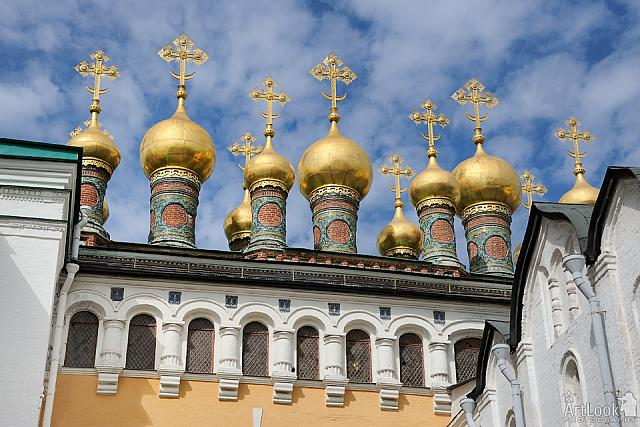 Gilded Cupolas of Terem Palace Churches Against Beautiful Skies