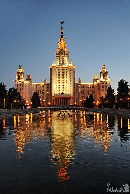 Moscow State University at Twilight with Golden Reflection in Water