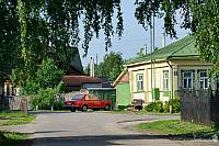 Suzdal Cityscapes – The Old Russian Car in front of a Wooden House