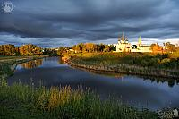 Suzdal Kremlin at Kamenka River under Grey Clouds in Sweet Light