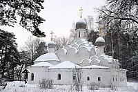 The Church of Archangel Michael framed with Trees in Snow