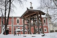 Old Style Belfry with Bells in the Snow