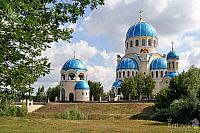 The Holy Trinity Cathedral with Shining Blue Domes Framed with Trees