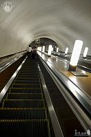 Going Down the Long Escalator at Smolenskaya Metro Station