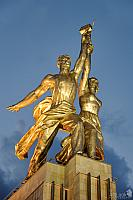 Sculpture of Worker and Collective Farmer in Gold Light at Sunset