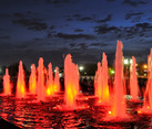 Colored Red Light Fountains in Victory Park Against Dusk Sky