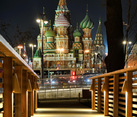 Wooden Bridge Leading to St. Basil's Cathedral at Autumn Night