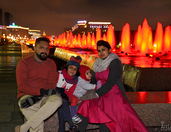 At the Red Illuminated Fountains in Victory Park at Night