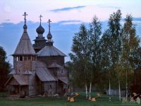 Sunset over the Wooden Churches and Birch Trees