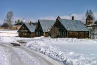 Winter Road to the Timber Houses of Pokrovsky Hotel