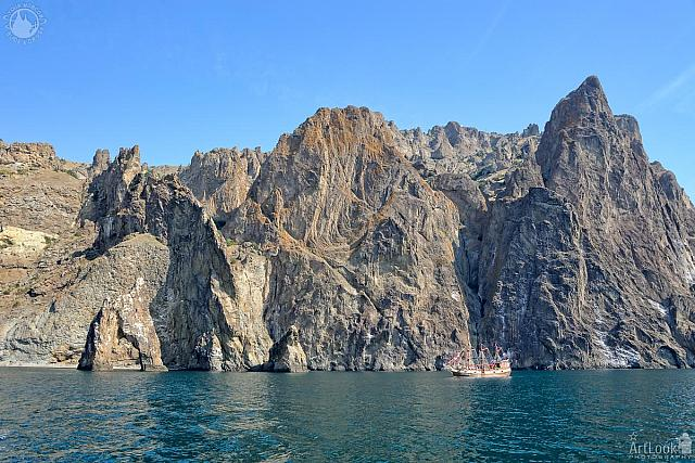 Yacht Approaching the Golden Gate Cliff at Kara Dag Mountain
