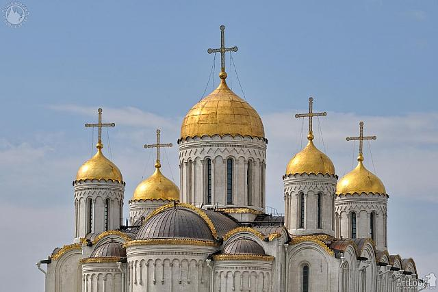 Golden Domes of Assumption Cathedral Against the Blue Sky