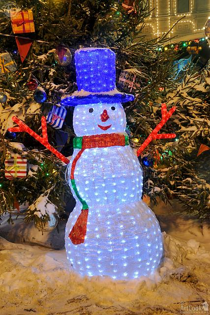 Funny LED Snowman in a Blue Hat on the Red Square