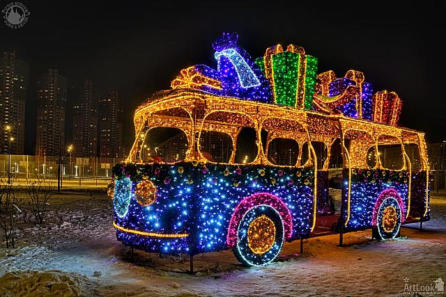Illuminated New Year Bus With Gifts at Night