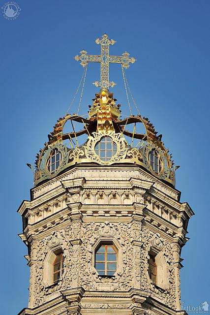 Golden Crown With Cross of Dubrovitsy Church Against Blue Sky