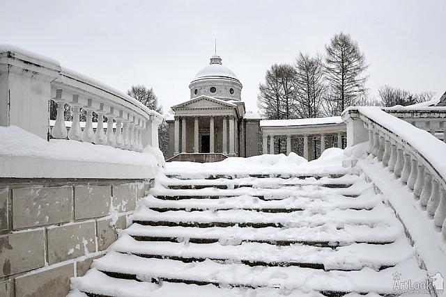 Snow Covered Steps with Balustrade in Colonnade