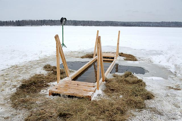 Cross-shaped Ice Hole with Wooden Platform