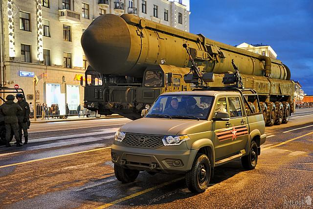 Military Pickup UAZ and ICBM Yars in Twilight