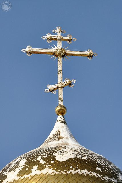 Gilded Russian Orthodox Cross on the Church Cupola in the Snow