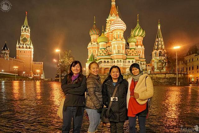 At St. Basil's Cathedral and Savior Tower Under Wet Snow