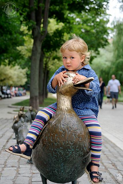 A Little Blonde on A Duck