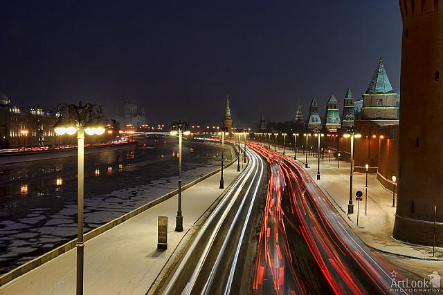 Traffic Lights on Kremlin Embankment During Snowfall at Twilight