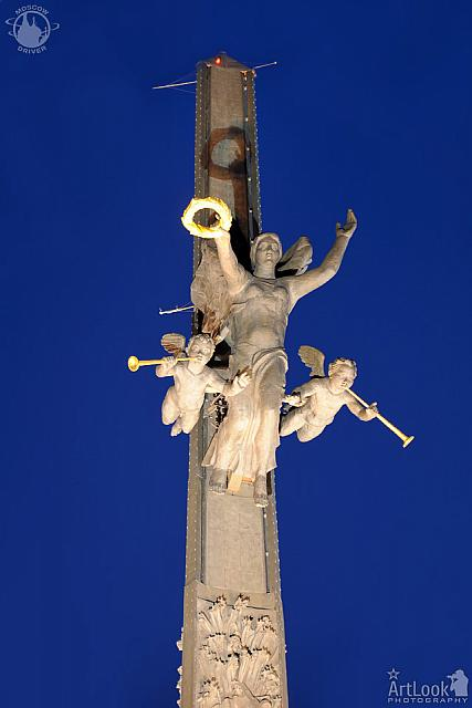Bronze Statue of Nike with Figures of Angels at Twilight