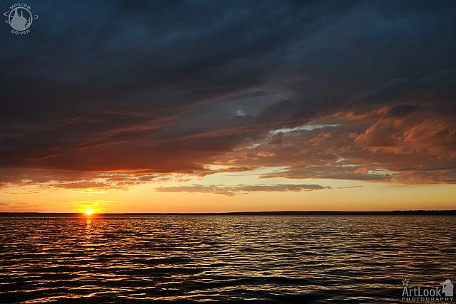 Amazing Sunset with Golden Light over Clouds at Pleshcheyevo Lake