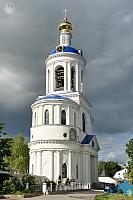 Gate Assumption Church with Bell Tower Against Storm Clouds