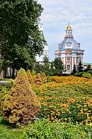 Flowers and small Smolenskaya Church on the grounds of Lavra