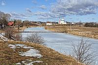 Frozen Kamenka River and Wooden Walking Bridge in Springtime
