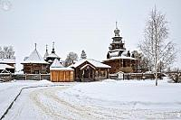 At the Entrance into Museum of Wooden Architecture Covered Snow