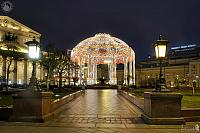 Arch with Dome Framed by Street Lights at Theater Square in Dusk