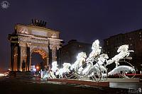 Lighted New Year Horses at Triumphal Arch in Dusk. Front Angle