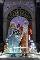 Ded Moroz and Snegurochka at Triumphal Gate in Morning Twilight