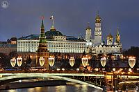 Lights of Bolshoy Kamenny Bridge at Moscow Kremlin in Twilight