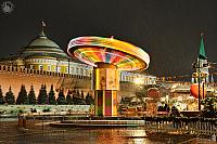 Colorful Spinning Carousel at the Red Square in Snowfall