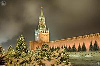 Kremlin's Spasskaya Tower Framed by Christmas Trees in Snow