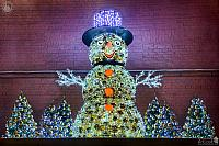 Snowman in Hat with Christmas Trees at the Wall of Power Plant #1