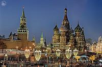 Kremlin Clock Tower and St. Basil's Cathedral Framed by Festive Street Lights in Twilight