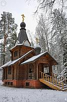 Snow-Covered Boris and Gleb Chapel in the Pine Woods
