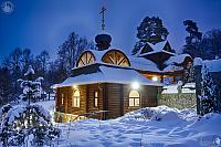 Wooden House-Chapel with Font After Snowfall in Winter Twilight