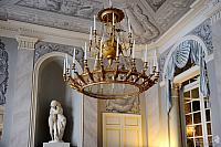 28-candle molded gilt chandelier in Grand Vestibule
