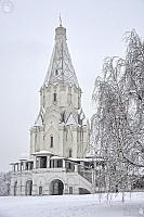 Snow-Covered Ascension Church Framed by Birch Tree