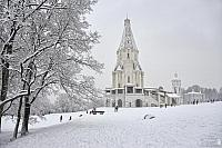 Tent-Roofed Ascension Church Framed by Trees in Snowfall