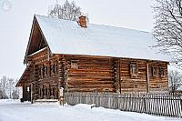 Wooden House of Prosperous Peasant in Snow (Angle view)