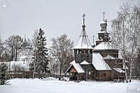 Snow-Covered Ensemble of Wooden Churches Framed by Trees