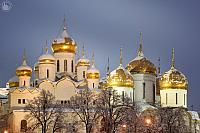 Snow-Covered Golden Domes of Moscow Kremlin in Twilight