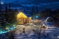 Snow-covered Dacha in a Winter Twilight